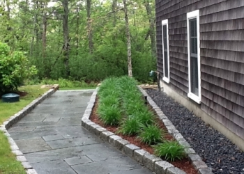 Walkway and flower bed with stone masonry